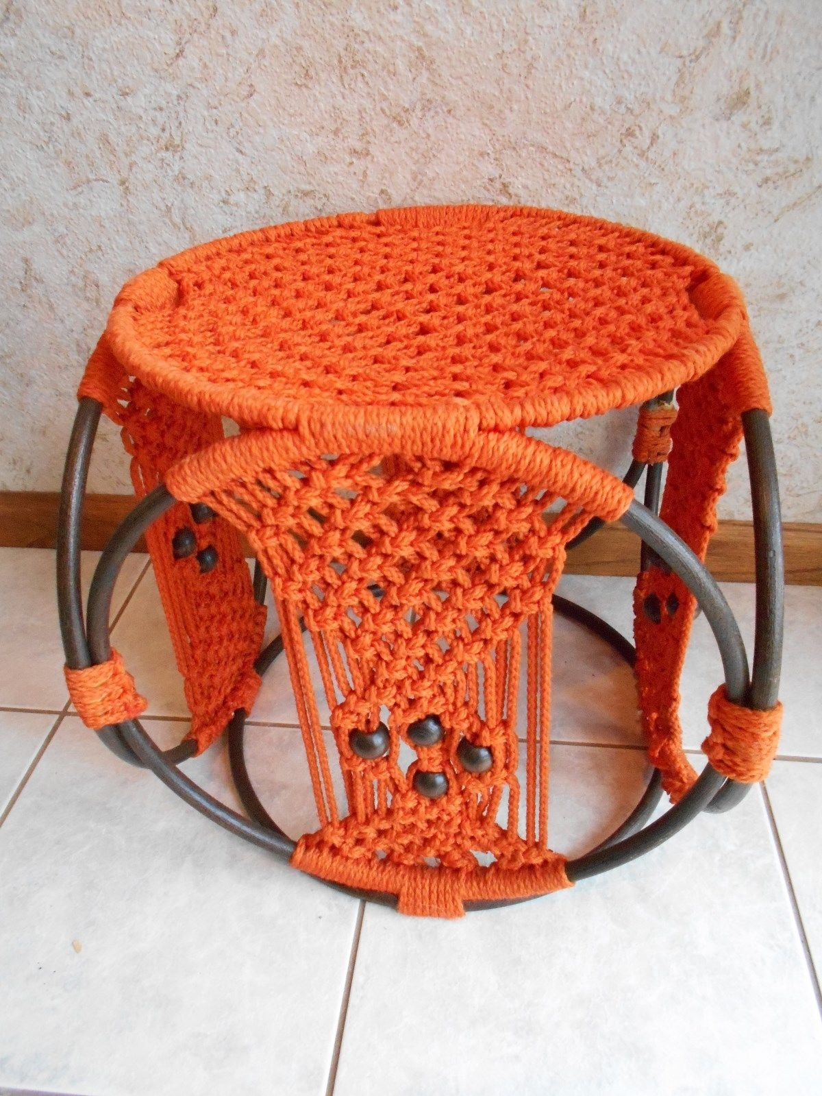 orange macrame footstool